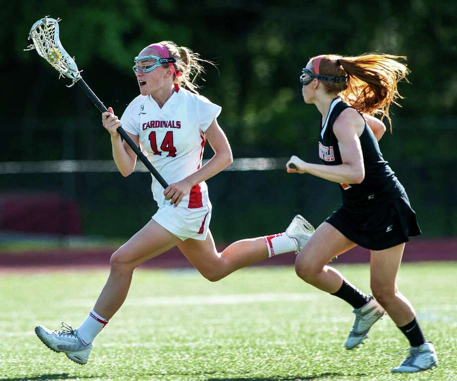 Greenwich high school's Anne Dunster moves the ball upfield during a FCIAC quarterfinal girls lacrosse game against Ridgefield high school played at Greenwich high school, Greenwich, CT on Friday, May 17th, 2013. Photo: Mark Conrad / Stamford Advocate Freelance