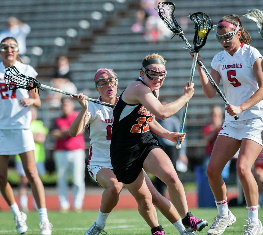 Ridgefield high school's Hannah Dighton tries to get by several Greenwich high school players during an FCIAC quarterfinal girls lacrosse game played at Greenwich high school, Greenwich, CT on Friday, May 17th, 2013. Photo: Mark Conrad / Stamford Advocate Freelance