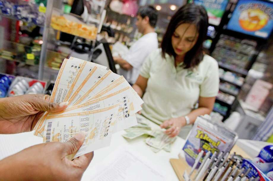 Radhika Kharel's shift Friday at Paradise Cards & Gifts was nonstop Powerball sales. Saturday's jackpot exceeds $600 million. Photo: Johnny Hanson, Staff / © 2013  Houston Chronicle