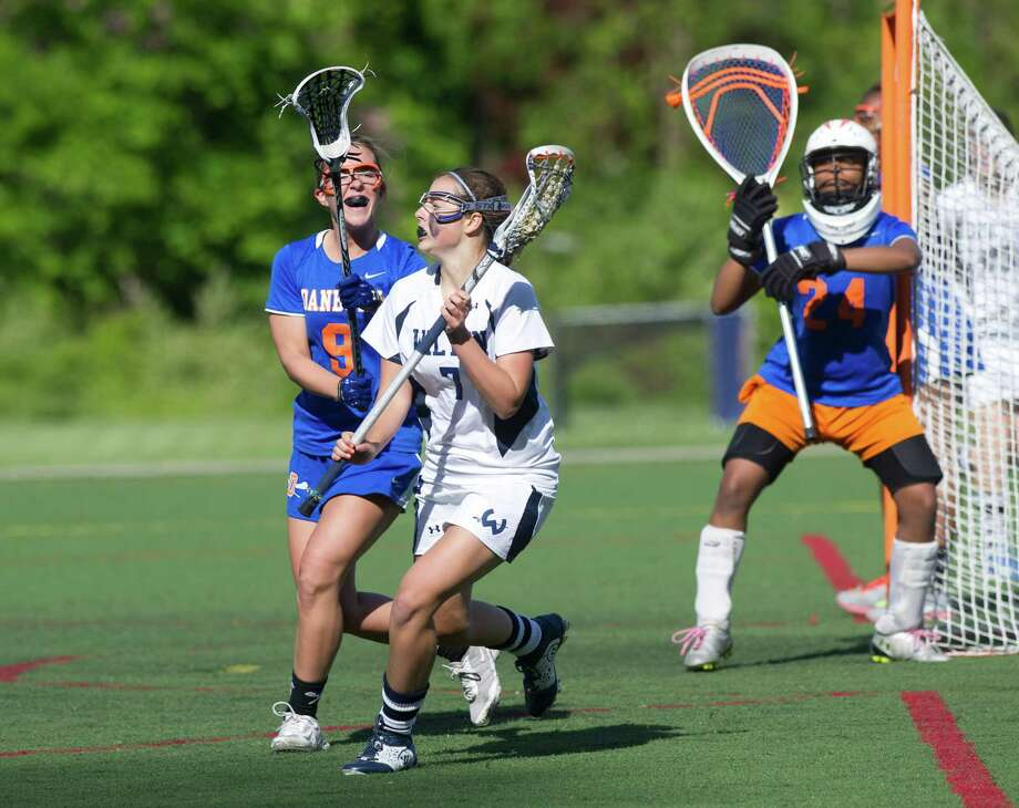 Wilton's Annie Cornbrooks controls the ball as she is defended by Danbury's Anna Jones during Friday's FCIAC girls lacrosse quarterfinal game at Wilton High School on May 17, 2013. Photo: Lindsay Perry / Stamford Advocate