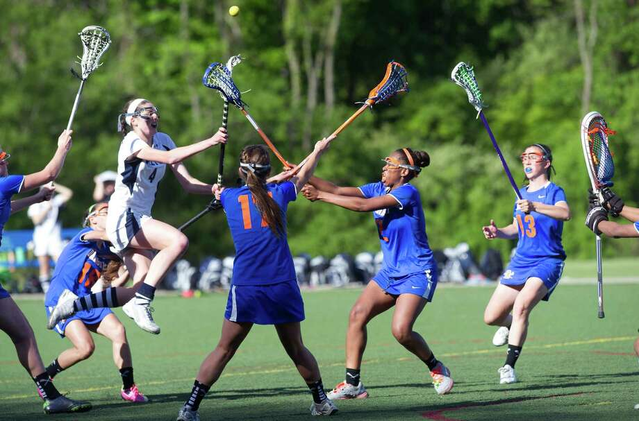 Wilton's Katherine Vincent takes a shot during Friday's FCIAC girls lacrosse quarterfinal game at Wilton High School on May 17, 2013. Photo: Lindsay Perry / Stamford Advocate