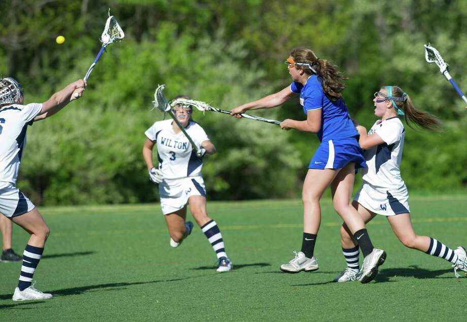 Danbury's Molly Miller scores a goal during Friday's FCIAC girls lacrosse quarterfinal game at Wilton High School on May 17, 2013. Photo: Lindsay Perry / Stamford Advocate