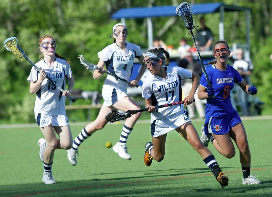 Wilton's Laine Parsons chases down a loose ball during Friday's FCIAC girls lacrosse quarterfinal game at Wilton High School on May 17, 2013. Photo: Lindsay Perry / Stamford Advocate