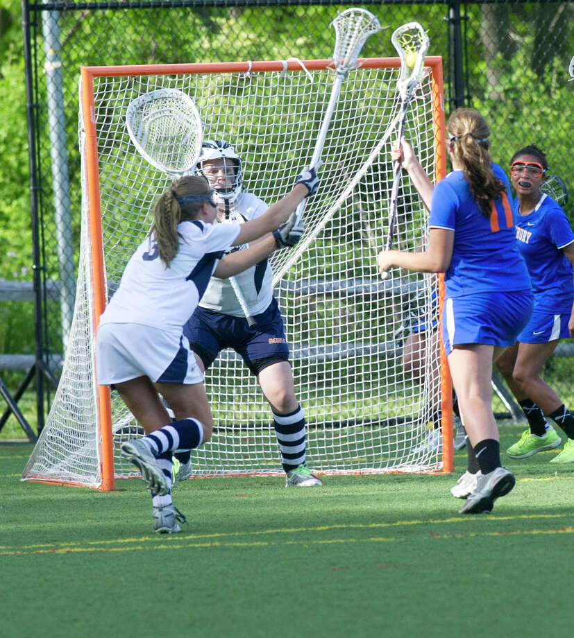 Danbury's Molly Miller scores a goal in the last six seconds of the game, tieing the score at seven goals each and forcing overtime during Friday's FCIAC girls lacrosse quarterfinal game at Wilton High School on May 17, 2013. Photo: Lindsay Perry / Stamford Advocate