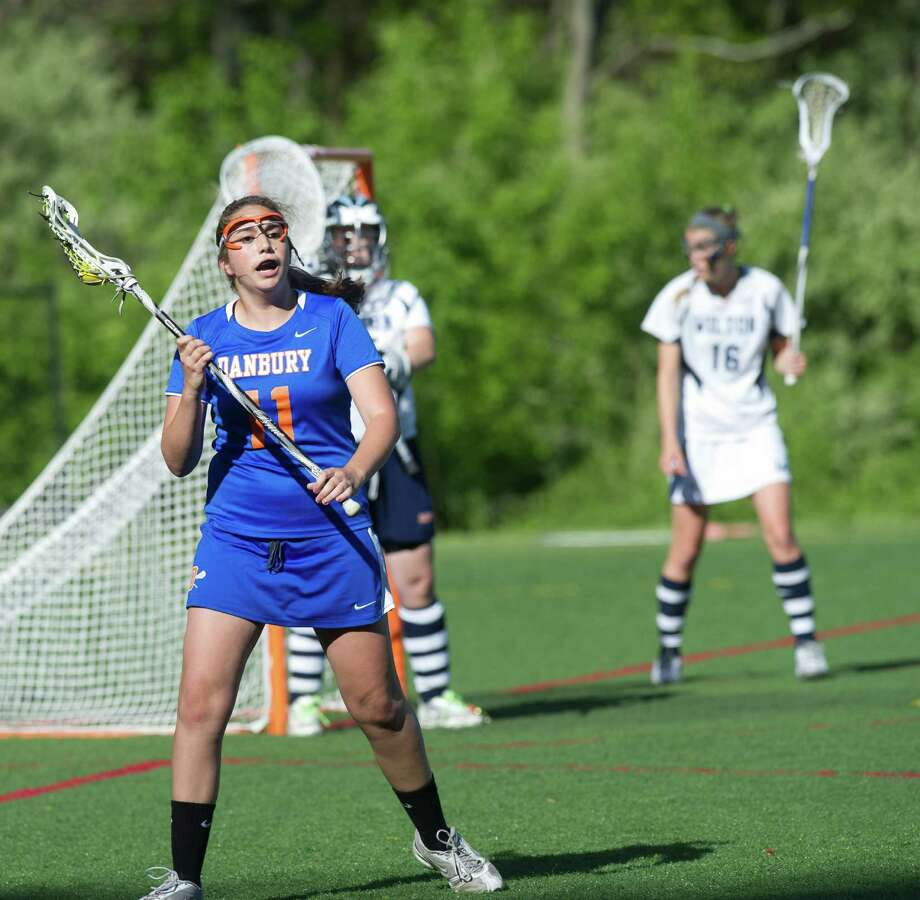 Danbury's Molly Miller controls the ball during Friday's FCIAC girls lacrosse quarterfinal game at Wilton High School on May 17, 2013. Photo: Lindsay Perry / Stamford Advocate