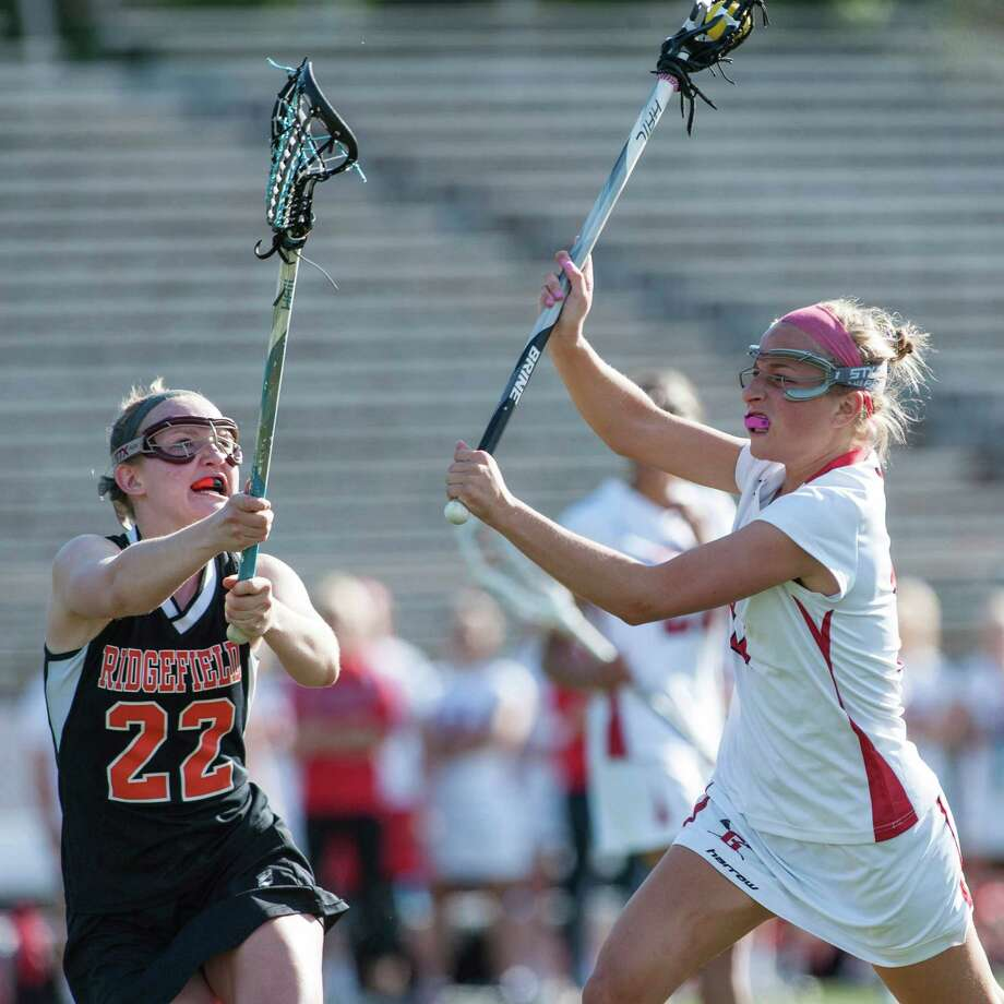 Greenwich high school's Sophie Waine takes a shot and scores during an FCIAC quarterfinal girls lacrosse game against Ridgefield high school played at Greenwich high school, Greenwich, CT on Friday, May 17th, 2013. Photo: Mark Conrad / Stamford Advocate Freelance