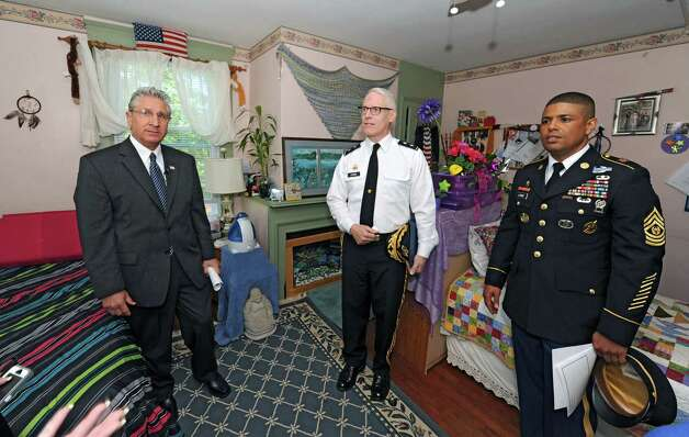 From left, Assemblyman Jim Tedisco, U.S. Army Major General Peter Lennon and Army Reserves Command Sgt. Major Nagee Lunde take a tour of the Guardian House for homeless female veterans Friday, May 17, 2013 in Ballston Spa, N.Y. Local officials are calling for a new voluntary tax check-off law to enable New Yorkers to contribute to programs and services for veterans. Guardian House just won $25,000 Home Depot award for improvements and is in running for top $250,000 prize. (Lori Van Buren / Times Union) Photo: Lori Van Buren / 10022451A