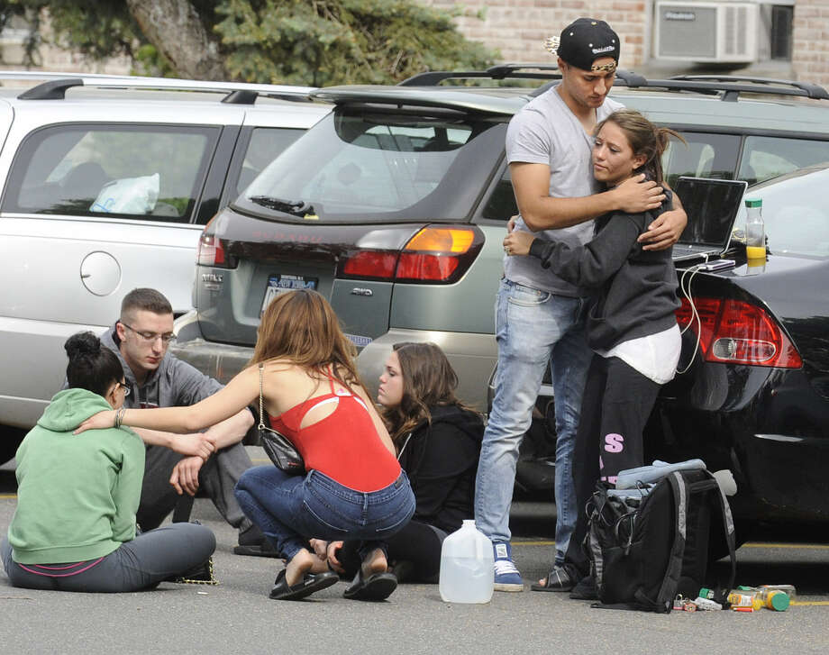 Hofstra University students gather near the house where a student and an armed intruder were killed during an overnight break-in near the campus in Uniondale, N.Y. Photo: Louis Lanzano / Associated Press