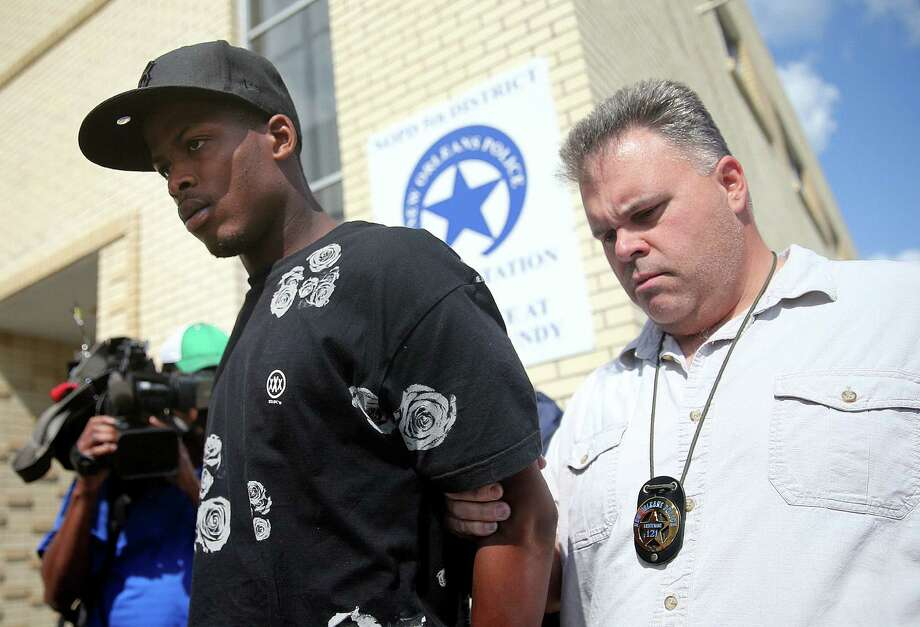 Shawn Scott is taken from a police station to prison. He and his brother are accused of the Mother's Day parade shooting. Photo: Michael DeMocker / Associated Press