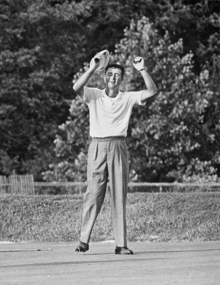 After his 12-foot putt nestled into the cup on the 18th green, Ken Venturi throws up his arms in celebration of his winning the 1964 U.S. Open golf title at Congressional CC in Bethesda, Maryland, June 20, 1964.