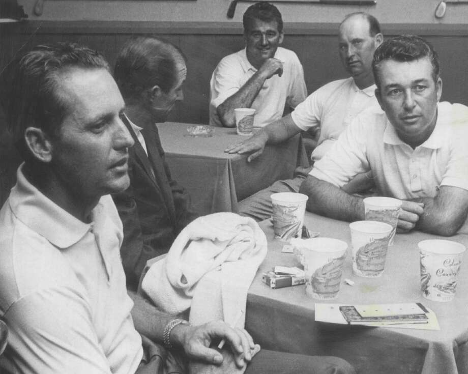 Tommy Jacobs (left) and Ken Venturi (right) take it easy in the Columbine club house after their practice rounds in 1967. Venturi toured the 7,436-yard layout in four-under-par 68.