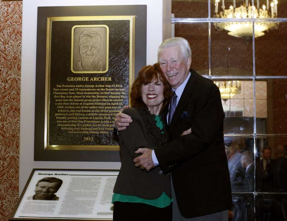 Ken Venturi (right) and Donna Archer, wife of late golfer George Archer, posing for a picture in front of Mr. Archer's Hall of Fame display  before the Bay Area Sports Hall of Fame 2012 banquet in San Francisco, Ca on Tuesday, March 13, 2012.