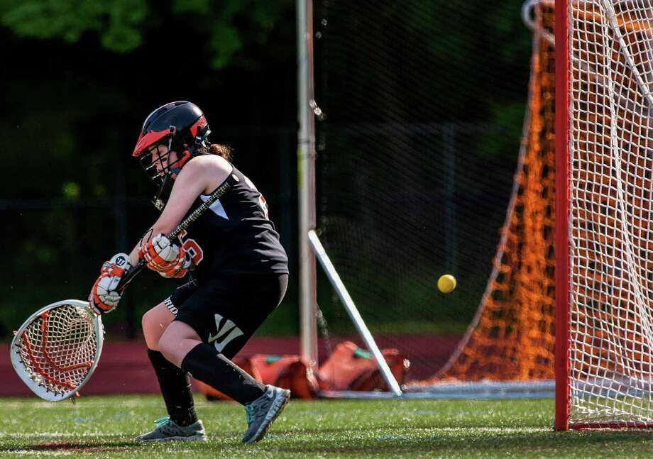Ridgefield high school goalie, Erin Norrison, can't stop this shot during an FCIAC quarterfinal girls lacrosse game against Greenwich high school played at Greenwich high school, Greenwich, CT on Friday, May 17th, 2013. Photo: Mark Conrad / Stamford Advocate Freelance