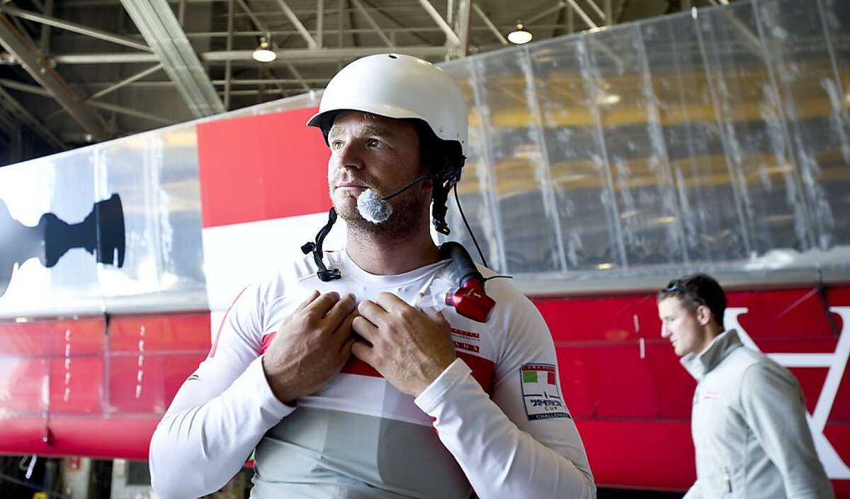 Luna Rossa bowman Nick Hutton demonstrates a chest protector at his team's base in Alameda, Calif., on Friday, May 17, 2013.