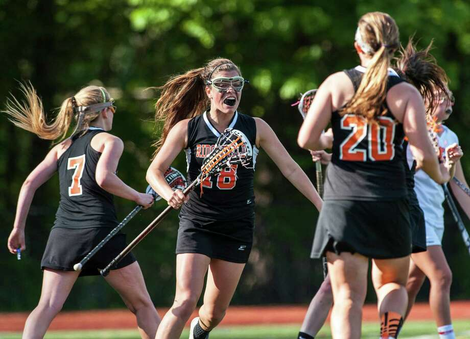 Ridgefield high school's Eliza Marcus celegrates a goal scored by her team during an FCIAC quarterfinal girls lacrosse game against Greenwich high school played at Greenwich high school, Greenwich, CT on Friday, May 17th, 2013. Photo: Mark Conrad / Stamford Advocate Freelance