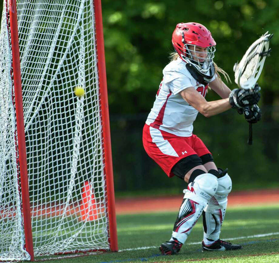 Greenwich high school goalie, Kylie Ginsberg, can't stop this shot during an FCIAC quarterfinal girls lacrosse game against Ridgefield high school played at Greenwich high school, Greenwich, CT on Friday, May 17th, 2013. Photo: Mark Conrad / Stamford Advocate Freelance