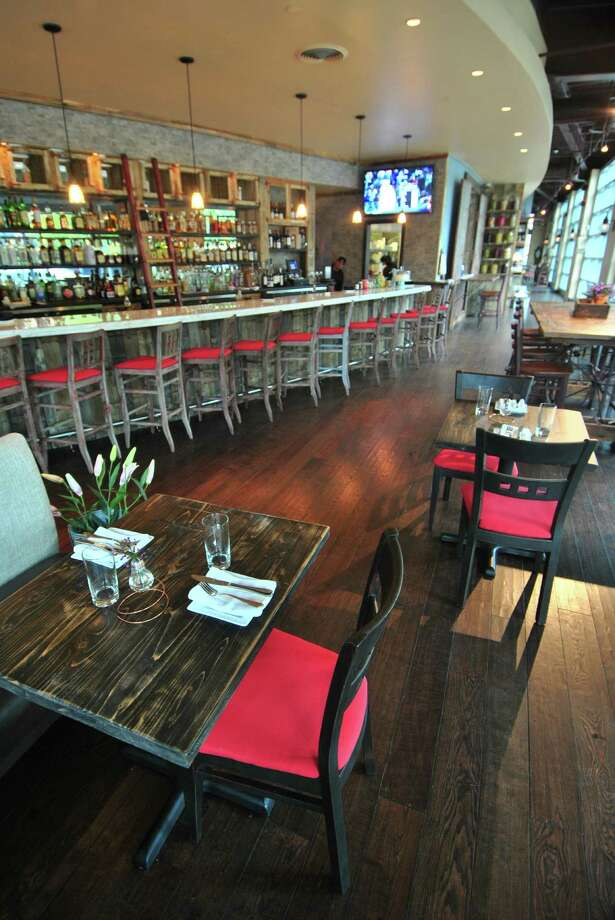 "Mama's Boy Southern Table & Refuge is bringing the ""south"" to South Norwalk. Thte owners have used reclaimed wood from a South Carolina water tower to refurbish the space at 19 Water St. and make it homey and comfortable. Photo: Jordan Osterhout / For The Norwa"