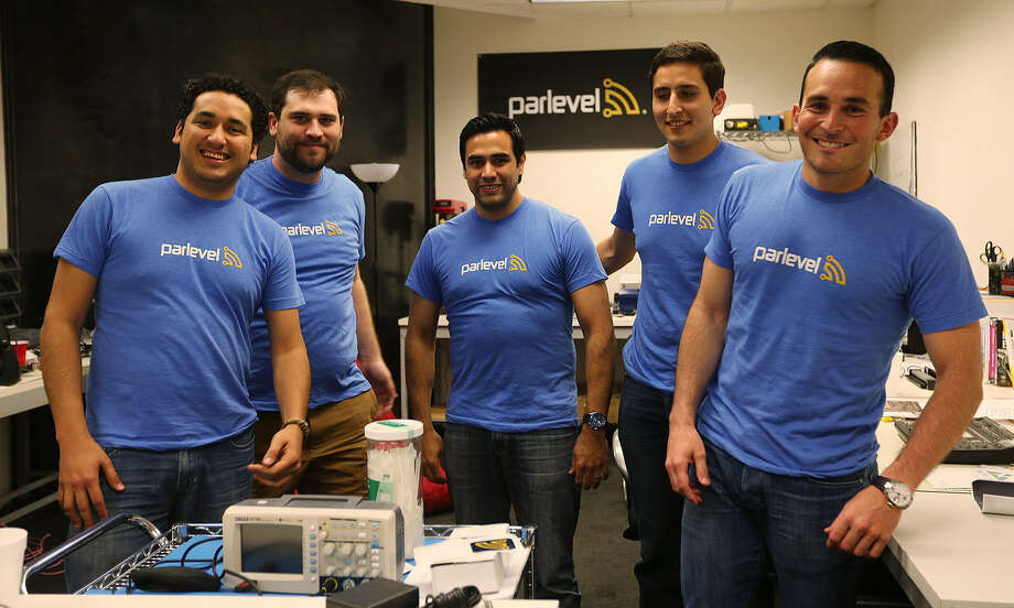 ParLevel's Alfonso Garcia, senior software engineer (from left); Jeremy Zunker, chief technology officer; Rafael Barroso, chief information officer; Walter Teele, chief operating officer; and Luis Gonzalez, chief executive officer, at their downtown office. Photo: Jerry Lara / San Antonio Express-News