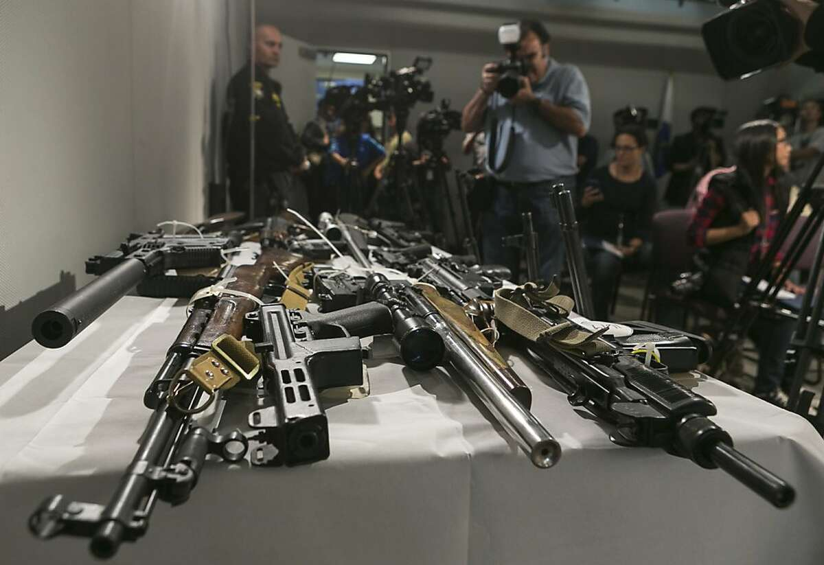 Firearms seized during recent Los Angeles Police sweeps, with the help of the California's Armed Prohibited Persons System (APPS) initiative, are displayed at a news conference with California Attorney General Kamala Harris, not seen, announcing the state's efforts to reduce gun violence at the Los Angeles Police headquarters in Los Angeles Friday, May 17, 2013. APPS is an online database that identifies persons who own or possess a firearm, and who subsequently become prohibited from possessing a firearm due to a history of violence, or because the person is suffering from mental illness.