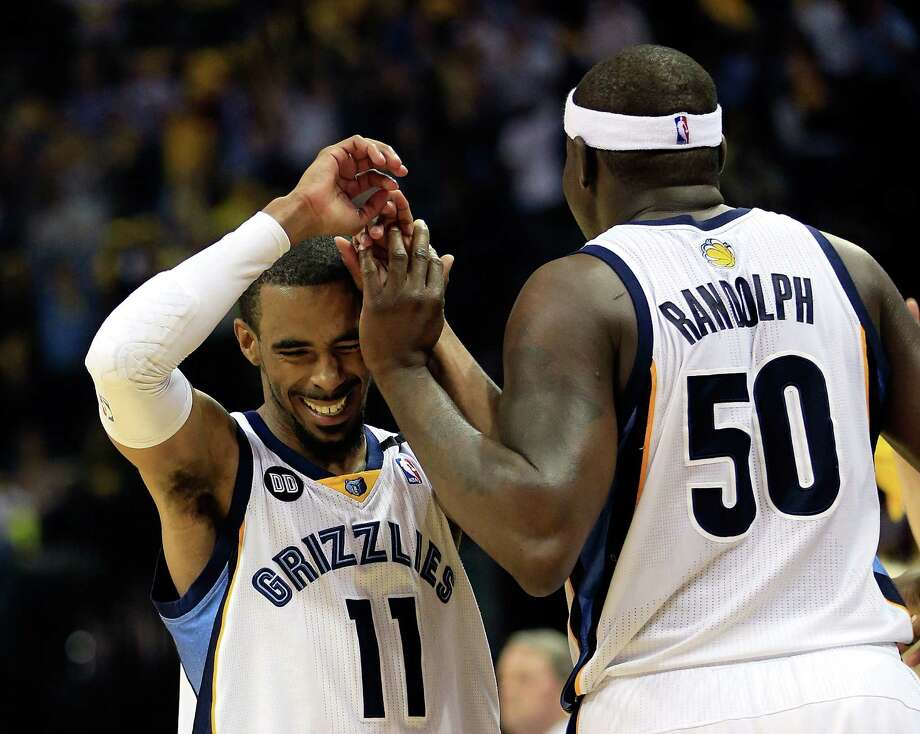 Mike Conley (left) and Zach Randolph — along with Marc Gasol — have helped lead the Grizzlies to new heights, even after the team traded leading scorer Rudy Gay in January. Photo: Jamie Squire / Getty Images