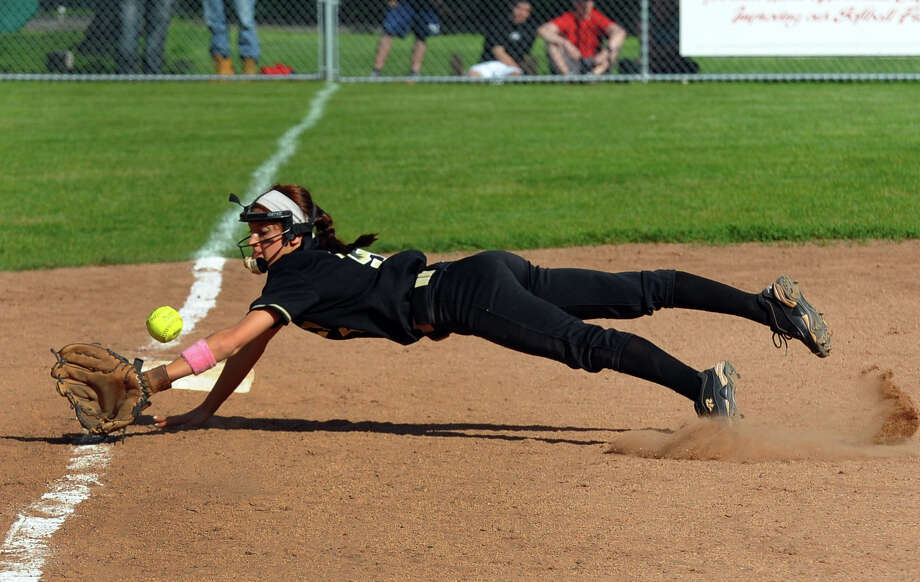 Jonathan Law third baseman Stephanie Peloso dives for a Foran grounder, during softball action in Milford, Conn. on Friday May 17, 2013. Photo: Christian Abraham / Connecticut Post