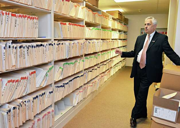 Rensselaer County Clerk Frank Merola next to stacks of some 20,000 pistol permits in the records room of the County Clerk's office in Troy, NY Friday May 17, 2013.  (John Carl D'Annibale / Times Union) Photo: John Carl D'Annibale / 00022478A