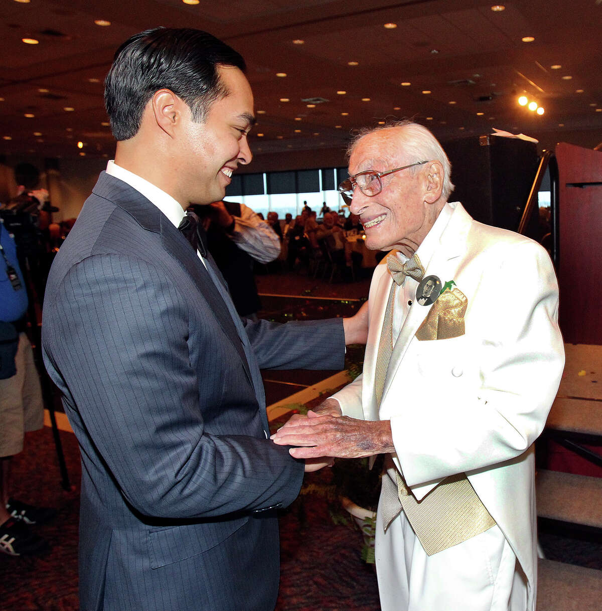 Bill Sinkin is greeted by Mayor Julian Castro as he celebrates his 100th birthday at a reception in the Skyroom at the University of the Incarnate Word on May 17, 2013.