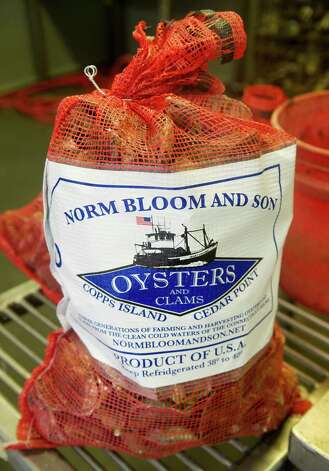 A bag of oysters sits ready to be sold at Norm Bloom and Son in Norwalk, Conn., on Friday, May 17, 2013. Photo: Lindsay Perry / Stamford Advocate