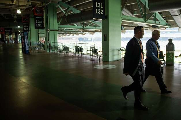 Reid Ryan, foreground, walks through the stadium with broadcaster Bill Brown after a press conference where he was announced as the new Astros president at Minute Maid Park on Friday, May 17, 2013, in Houston. Photo: Smiley N. Pool, Houston Chronicle / © 2013  Smiley N. Pool
