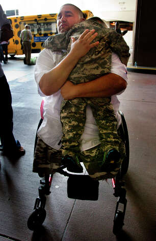 Wounded Warrior Hero Shane Parsons, hugs young friend, Lucas Suria, 4, after they arrived at Bush Intercontinental Airport Friday, May 17, 2013, in Houston. The arrival of the wounded warriors kicked off Warrior Weekend in which wounded veterans participate in a deep-sea fishing trip in Port O'Connor. Photo: Cody Duty, Houston Chronicle / © 2013 Houston Chronicle