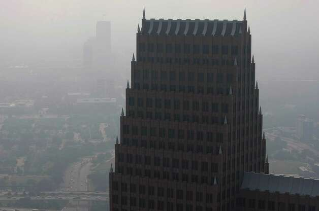 A haze fills the sky over downtown as seen from the Chase Tower Friday, May 17, 2013, in Houston. Photo: Johnny Hanson, Houston Chronicle / © 2013  Houston Chronicle