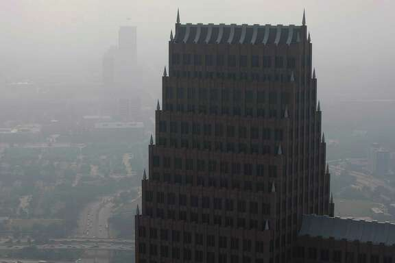 A haze fills the sky over downtown as seen from the Chase Tower Friday, May 17, 2013, in Houston.