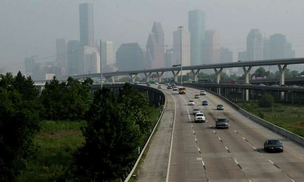 A smokey haze blankets the downtown Houston skyline Friday, May 17, 2013, in Houston. Photo: James Nielsen, Houston Chronicle / © 2013  Houston Chronicle