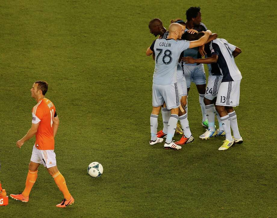 Brad Davis, left, and the rest of the Dynamo will try to put Sunday's loss, which ended a 36-game home unbeaten streak, behind them in time for today's match. Photo: Scott Halleran, Staff / 2013 Getty Images