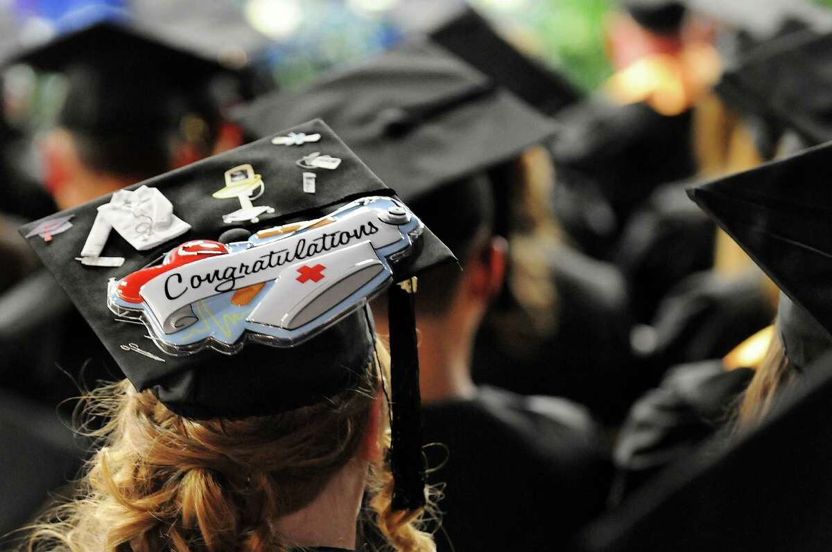 Nursing graduate Valerie Fosmire wears her career choice on her mortar board during college commencement on Friday, May 17, 2013, at Fulton-Montgomery Community College in Johnstown, N.Y. (Cindy Schultz / Times Union)