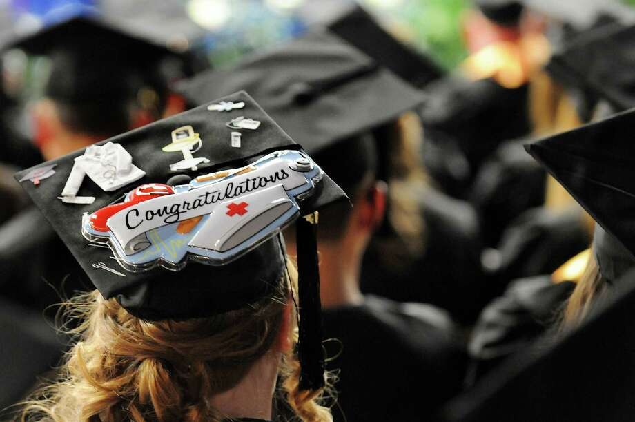 Nursing graduate Valerie Fosmire wears her career choice on her mortar board during college commencement on Friday, May 17, 2013, at Fulton-Montgomery Community College in Johnstown, N.Y. (Cindy Schultz / Times Union) Photo: Cindy Schultz / 10022126A