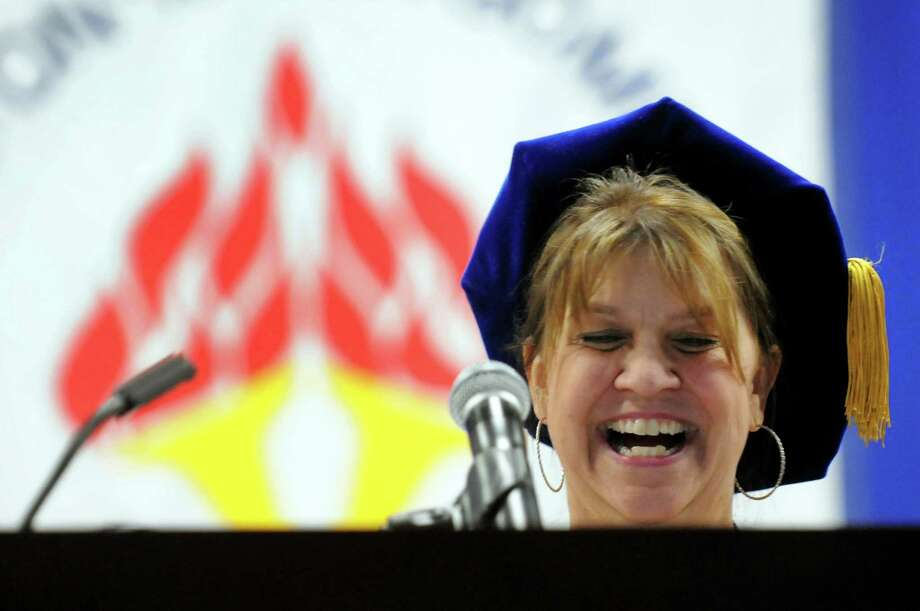 Tina Good, member of the SUNY Board of Trustees and president of the Faculty Council of Community Colleges, addresses graduates during college commencement on Friday, May 17, 2013, at Fulton-Montgomery Community College in Johnstown, N.Y. (Cindy Schultz / Times Union) Photo: Cindy Schultz / 10022126A