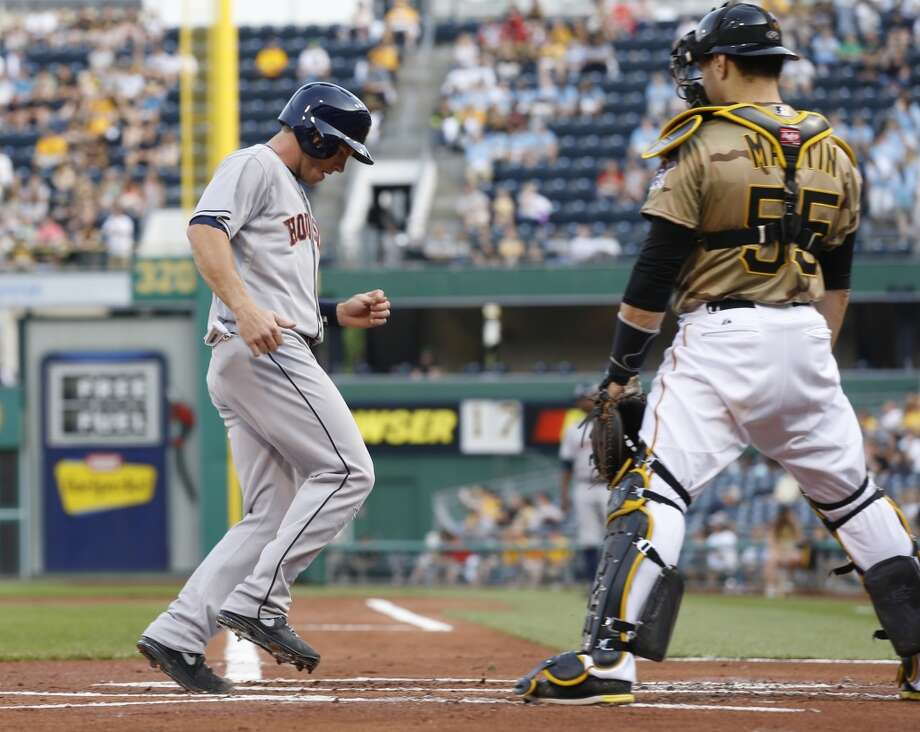 May 17: Pirates 5, Astros 4 Robbie Grossman of the Astros scores on a sacrifice fly hit by Chris Carter.