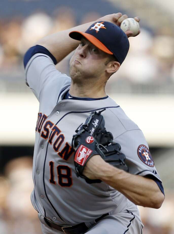 Astros pitcher Jordan Lyles throws against the Pirates.