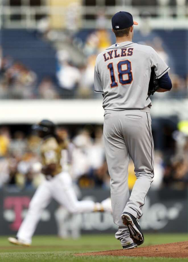 Astros pitcher Jordan Lyles looks away after giving up a home run to Andrew McCutchen of the Pirates.