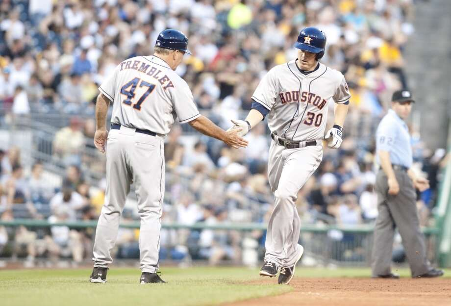 Matt Dominguez of the Astros is congratulated by third base coach Dave Trembley after hitting a home run during the fifth inning.