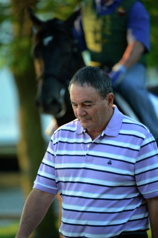 Itsmyluckyday's trainer Edie Plesa is deep in thought as he goes to the track early May 17, 2013 the day before the second jewel of the Triple Crown for thoroughbreds to be held at the Pimlico Race Course in Baltimore, MD.  (Skip Dickstein/Times Union) Photo: SKIP DICKSTEIN