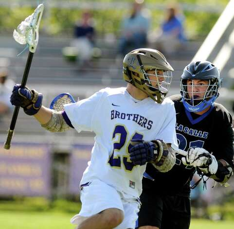 CBA's Andy Curro (29), left, controls the ball as LaSalle's Kevin Koberger (21) defends during their lacrosse game on Thursday, May 17, 2012, at Christian Brothers Academy in Colonie, N.Y. (Cindy Schultz / Times Union) Photo: Cindy Schultz / 00017677A