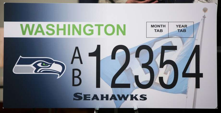 A view of the new Washington state Seahawks license plate Friday, May 17, 2013, at the Virginia Mason Athletic Center in Renton. The new plates will be available for purchase on Jan. 1, 2014.  Photo: JORDAN STEAD, SEATTLEPI.COM