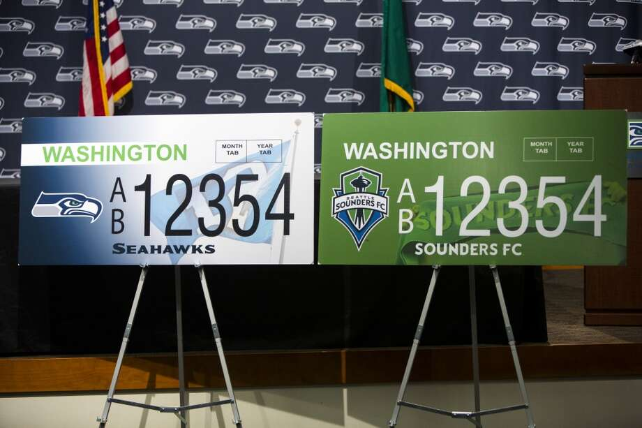 A view of the new Washington state Seahawks and Sounders FC themed license plates Friday, May 17, 2013, at the Virginia Mason Athletic Center in Renton. The new plates will be available for purchase on Jan. 1, 2014.  Photo: JORDAN STEAD, SEATTLEPI.COM