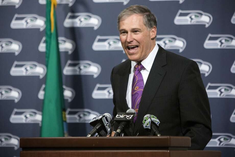 Gov. Jay Inslee addresses onlookers and media at the unveiling event of new Washington state Seahawks and Sounders FC themed license plates Friday, May 17, 2013, at the Virginia Mason Athletic Center in Renton. The new plates will be available for purchase on Jan. 1, 2014.  Photo: JORDAN STEAD, SEATTLEPI.COM