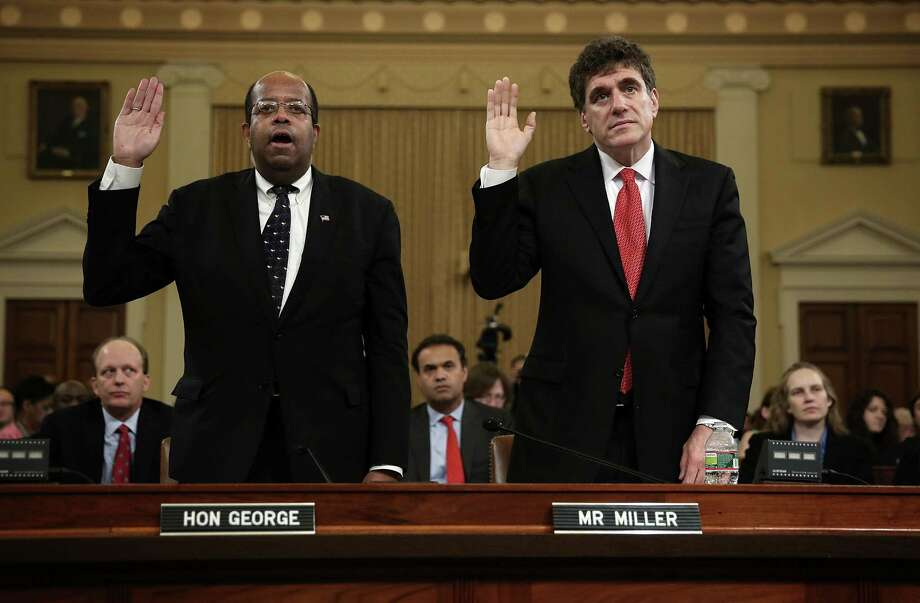 Treasury Inspector General for Tax Administration Russell George and Steven Miller, former acting commissioner of the IRS, are sworn in for the hearing before the House Ways and Means Committee. Photo: Alex Wong / Getty Images