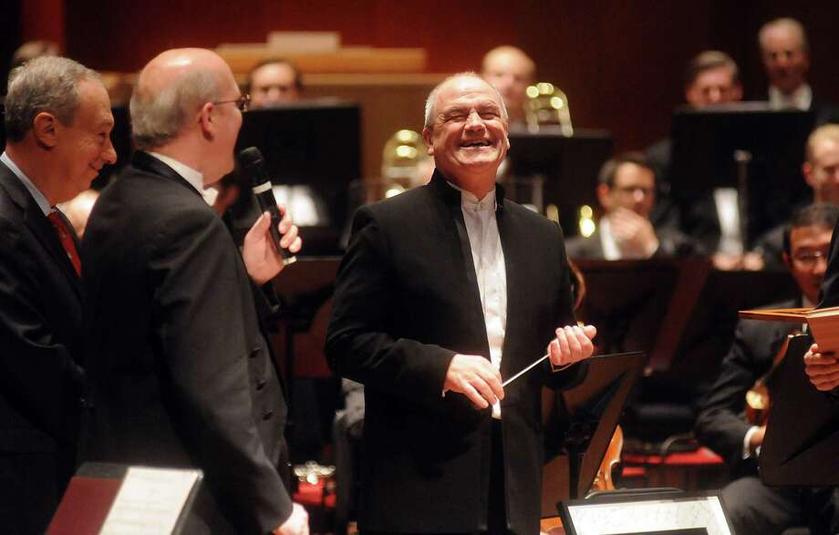 Hans Graf smiles as he receives gifts from Mark Hanson, Bob Peiser and Jeff Butler before final night with the Houston Symphony at Jones Hall Friday. Photo: Dave Rossman, Freelance / © 2013 Dave Rossman