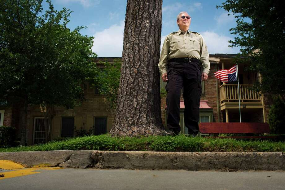 Billy Martin poses in front of his Houston townhouse. A similar case two years ago spawned a new state law protecting flag displays from HOA rules. The same lawyer who represented that homeowner is Martin's pro bono lawyer. Photo: Eric Kayne / 2013 Eric Kayne