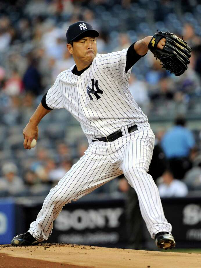 New York Yankees pitcher Hiroki Kuroda delivers the ball to the Toronto Blue Jays during the first inning of a baseball game Friday, May 17, 2013, at Yankee Stadium in New York. (AP Photo/Bill Kostroun) Photo: Bill Kostroun